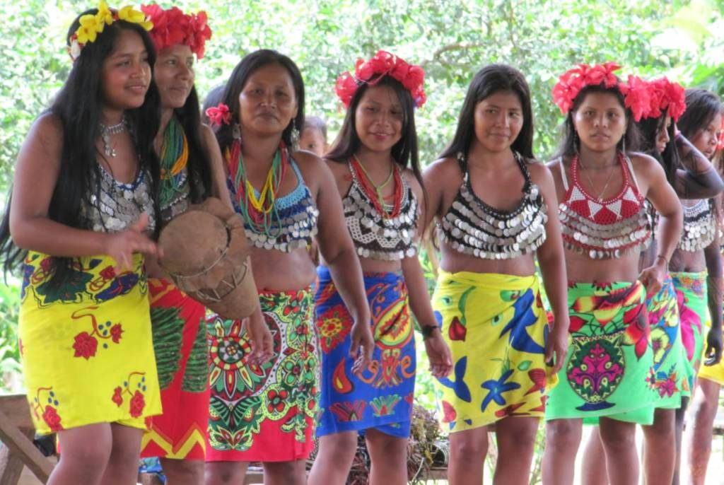 Group of Embera girls playing music and dancing for the tourists in Panama